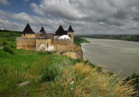 Ukraine, Hotinskaya fortress in Khotyn city of Chernivtsi region under the blue sky on the banks of the Dniester River on May 3, 2015