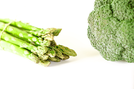 Food background asparagus and broccoli flat lay pattern. bunch of fresh green asparagus on white background, top view. isolated