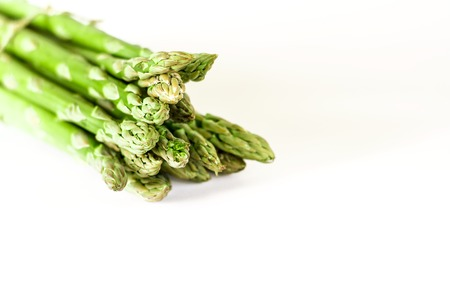 Food background asparagus flat lay pattern. bunch of fresh green asparagus on white background, top view. isolated