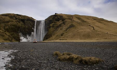 Skogafoss waterfall on the Skougau river, in the south of Iceland, in the Sydurland region, located in the cliffs of the former coastline near the village of Skogar, just below the Eyjafjallaj kull glacier