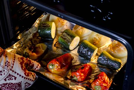 Healthy food. Pepper and zucchini with a ruddy crust are prepared in the oven. Close-up. Grilled vegetables