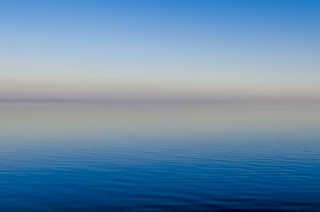 Blue Misty sunset over the River with pink horizon