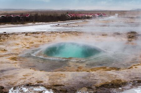 The eruption of the Strokkur geyser in the southwestern part of Iceland in a geothermal area near the river Hvitau
