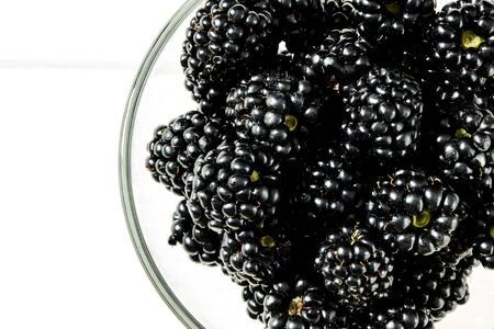 Large juicy black blackberry berries close-up with copy space top view 스톡 콘텐츠