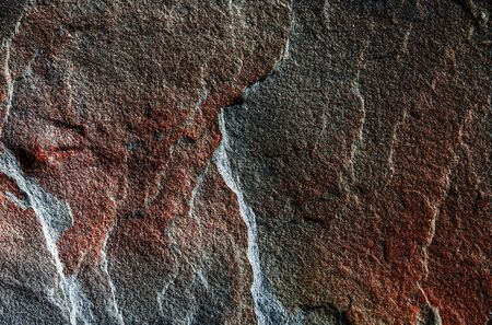 A natural background made of multi-colored wild stone close-up. Top View Banque d'images - 133066089