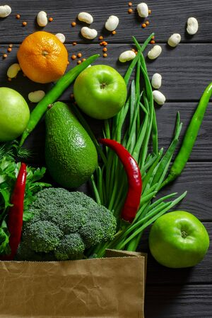 Healthy food clean eating selection: fruit, vegetable, seeds, super food, cereals, leaf vegetable on gray concrete background copy space Banco de Imagens