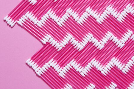Hygiene: multi-colored plastic cotton buds lie on the yak background. Close-up. Top view, flat lay Banco de Imagens