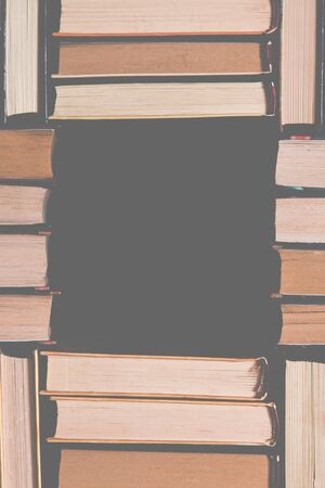 Books. Lots of colourful thick open books stand on a dark background