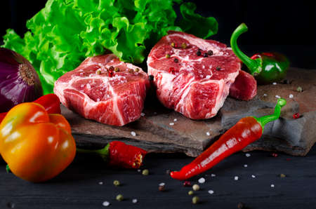 Meaty juicy marble steaks lie on wild stone Stockfoto