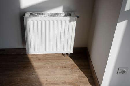 White metal radiator to heat the house and apartment Stockfoto