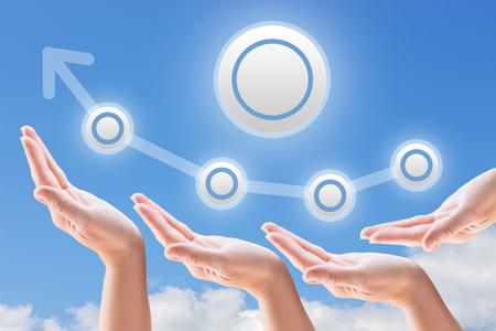 lift hands: hands support the growth and promotion on the background of sky and clouds Stock Photo
