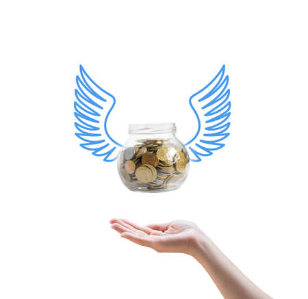 Bank with coins fly in hand on a white background .Idea for web design, promotion banners, infographic templates.