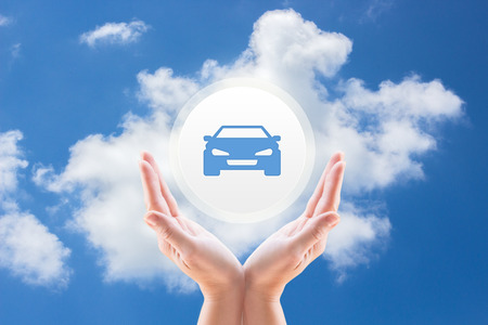 safeness: Hands under the car against the sky with clouds. Stock Photo
