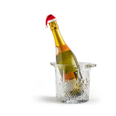 Champagne bottle in a bucket in the cap of Santa Claus Stock Photo