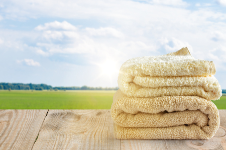 clean towels on the background of sky with clouds and green grass Stock Photo