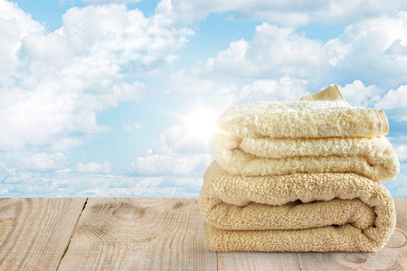 clean towels on the background of sky with clouds Stock Photo