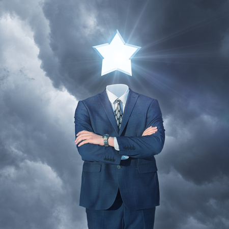 popular: Businessman with star instead of the head. Stock Photo