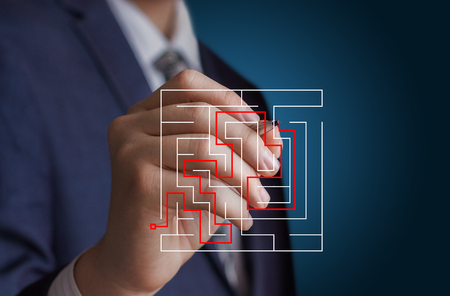cut through the maze: Businessman draws the solution of the problem.
