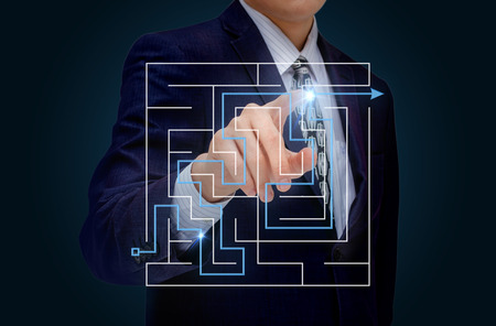 cut through the maze: Businessman analyzes the solution of the problem.