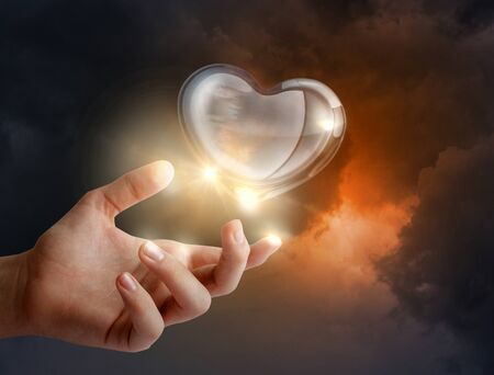 heart in hand: Glass heart in his hand.