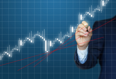 Businessman analyzes the chart on the stock exchange. Stock Photo
