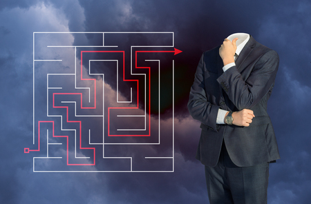 cut through the maze: Businessman ponders the solution to the problem.