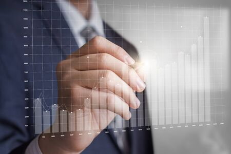 growth chart: Business man draws a profit growth chart. Concept of a successful trade.