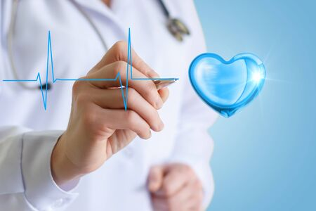 Doctor draws a cardiogram heart . Stock Photo