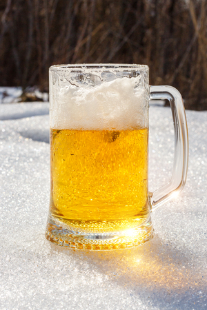 Glass of beer in the snow design banner.