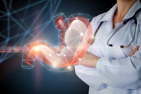 Gastroenterologist and stomach on blue background concept design.