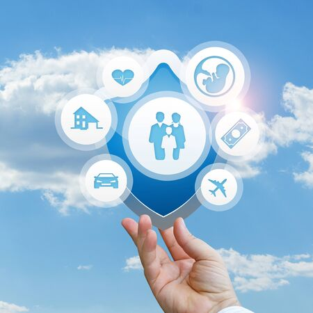 Insurance services in the hand conceptual design. Stock Photo