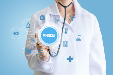 Doctor hand with stethoscope medical word and icons.