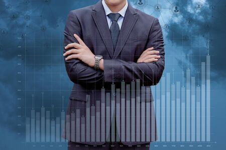Businessman analyzes the graph of growth on the glass.