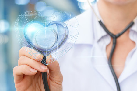 The doctor the Cardiologist listens to the heart of man. Stock Photo
