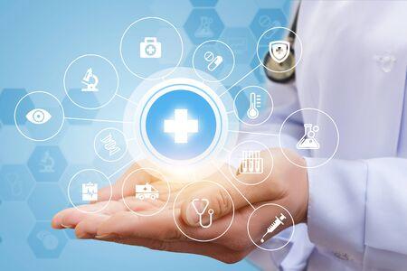 genomics: Medical cares in the form of a set of symbols in hands doctor.