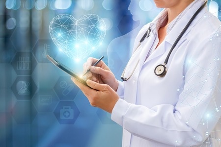 Doctor works on your computer on blurred background. Stock Photo