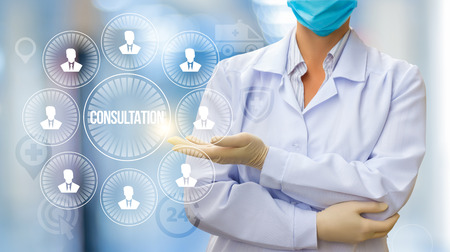 Doctor conducts a consultation with patients on blurred background.