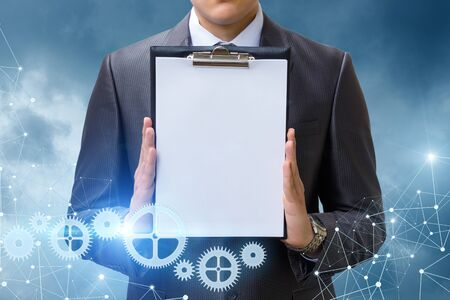 advice: The list in hand businessman on blue background.