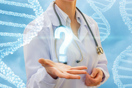Question mark in the hand doctor on the background DNA.