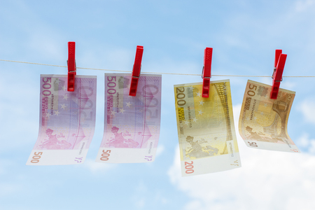 Euro banknote on a rope weigh and dried in the sky. Stock Photo
