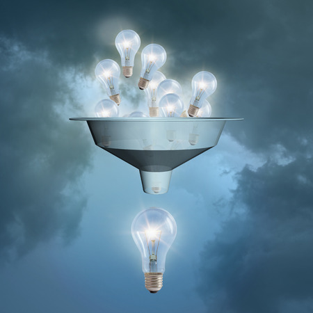 A lot of little ideas flow through the funnel against the sky. The concept of big ideas. Stock Photo