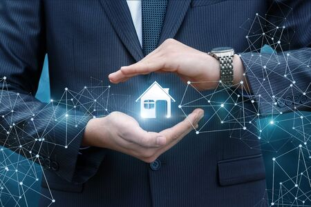 small business: Protecting real estate with a gesture of arms on a blue background.