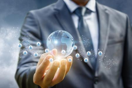 Business man holds in hand a global business network. Standard-Bild