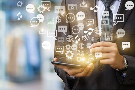 mobile communication: Tablet businessman Emits a holographic image of social media related icons. Stock Photo