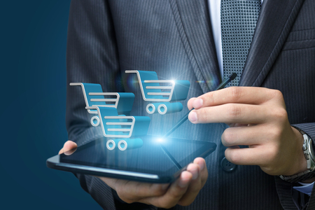 marketing online: On the tablet the businessman makes a purchase in the online store.