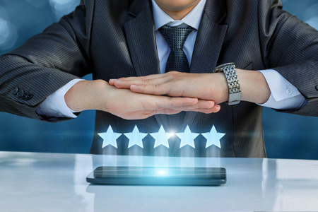 five stars: Business man protects a rating out of five stars.