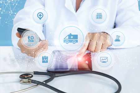 Doctor shows the medical machine icon on the screen. Concept ambulance. Stock Photo
