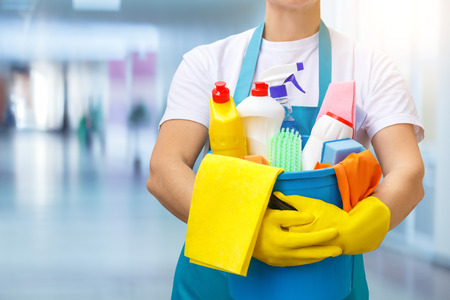Cleaner with a bucket and cleaners on a blurred background. Stock Photo - 89023700