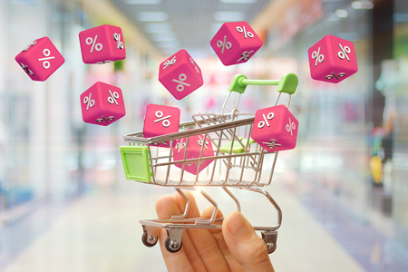 From shopping carts flying cubes with interest. The concept of discounts.