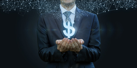 In the hands of a businessman appears the dollar sign from the network connections . The concept of electronic money. Stock Photo